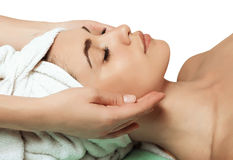 Anti aging facial massage. Beautiful and young girl doing anti-aging facial massage Stock Photo