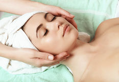 Anti aging facial massage. Beautiful and young girl doing anti-aging facial massage Royalty Free Stock Image