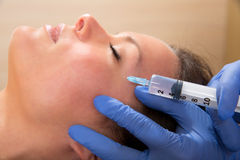 Anti aging facial mesotherapy syringe on woman face Royalty Free Stock Photography