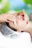 Anti-aging massage, anti-wrinkle treatment, facial skin care. Beautiful and well-groomed girl doing facial massage, Wrinkle control, close-up portrait, smooth Stock Photo