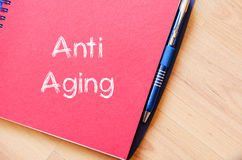 Anti aging write on notebook. Anti aging text concept write on notebook Stock Photography