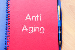 Anti aging write on notebook Royalty Free Stock Photo