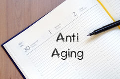 Anti aging write on notebook Royalty Free Stock Photography