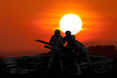 Anti Aircraft fire machine gun and three soldier in silhouette Royalty Free Stock Image