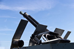 Anti-aircraft machine gun on a navy ship Stock Photography