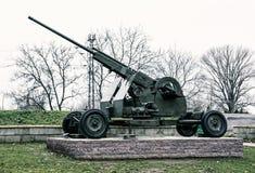 Anti-aircraft machine gun, war industry, cold photo filter Stock Image