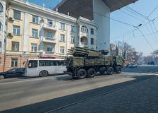 Anti-aircraft missile system is driven down street. Royalty Free Stock Image