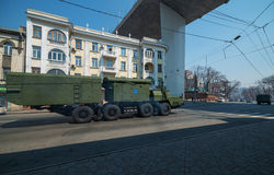 Anti-aircraft missile system is driven down street. Stock Photo