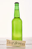 Anti alcoholism concept, wooden background. Stock Photography
