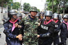 Anti-Amnesty Bill Rally in Bangkok. Captain Songklod Chuenchupol of the anti-government Thai Patriots Network is escorted away by riot police after being Stock Photo