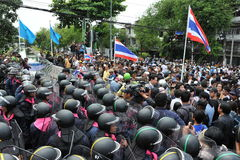 Anti-Amnesty Bill Rally in Bangkok. A group of anti-government protesters confront police near the Thai parliament on August 7, 2013 in Bangkok, Thailand. The Royalty Free Stock Photography