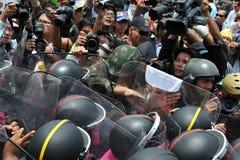 Anti-Amnesty Bill Rally in Bangkok. Protesters confront riot police at a barricade near parliament during an anti-amnesty bill rally on August 7, 2013 in Bangkok Stock Image