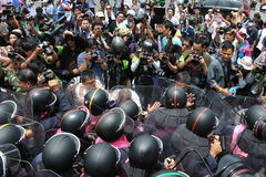 Anti-Amnesty Bill Rally in Bangkok. Protesters confront riot police at a barricade near parliament during an anti-amnesty bill rally on August 7, 2013 in Bangkok Royalty Free Stock Photography