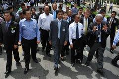 Anti-Amnesty Bill Rally in Bangkok. Senior Thai Democrat Party members, including leader and former Prime Minister Abhisit Vejjajiva (C), Chuan Leekpai (CR) and Royalty Free Stock Photo
