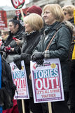 Anti-Austerity March. Two women, who look comfortably well off, attend a rally in London against the government austerity measures. People of all classes and Stock Images