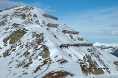 Anti avalanche structures on the side of a mountain Royalty Free Stock Photos