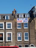 Anti-Brexit banner - For *U*K`s sake, Stop Brexit - at the top of a building in London. royalty free stock photo