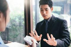 Anti bribery and Anti Corruption concepts. Businessman refusing bribe Royalty Free Stock Photos
