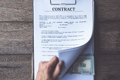 Anti bribery and corruption concepts, money offered in file, giving money in file while making deal to agreement royalty free stock photo
