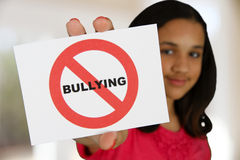 Anti Bullying. Teen girl holding a card that says no bullying Stock Photography