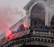 Anti capitalist demonstrators on the rialto bridge in venice. With masks and flares with smoke Royalty Free Stock Photography