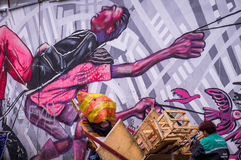 Anti-capitalistic Street Art in Bogota. Bogota, Colombia on December 14, 2015: Wall covered in anti-capitalistic street art by artist Guache in La Candelaria Royalty Free Stock Image