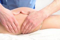 Anti cellulite massage Stock Photos
