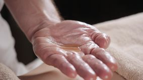 Close Up Pours Oil In The Palm Osteopath Doing Manipulative Massage On Female Abdomen