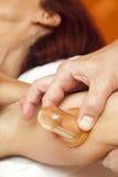Anti cellulite massage with Ventuza vacuum body puller Stock Images