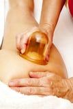 Anti cellulite massage with Ventuza vacuum body puller Stock Photos