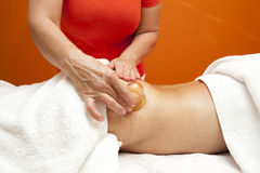 Anti cellulite massage with Ventuza vacuum body puller Stock Photos