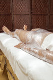 Anti cellulite treatment, body wrapping. Mid aged female body being wrapped around with foil to reduce fat, special anti cellulite treatment, series of HQ photos Stock Photos