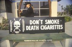 Anti-cigarette slogan. On bus stop Stock Photography