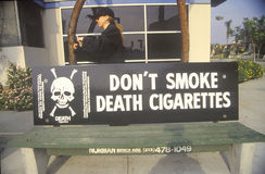 Anti-cigarette slogan on bus stop Stock Image