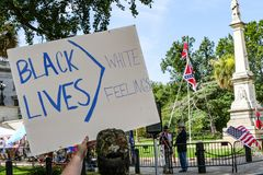 Anti-Confederate Flag protesters. Gather at South Carolina Statehouse to counter the Flag supporters near the Confederate Soldier Monument Stock Image
