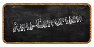 ANTI CORRUPTION écrite dans la craie sur le tableau noir Trame en bois Image stock