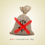 Anti-corruption day. A burlap money bag with two diagonal red slashes for the anti-corruption day Royalty Free Stock Images