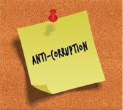 ANTI CORRUPTION manuscrite sur la note de papier collante jaune au-dessus du fond de panneau d'affichage de liège Photos stock