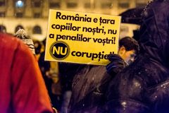 Anti-corruption protest in Bucharest. Masive Anti-corruption protest in Bucharest, Roumania. People with messages written on banners. Event from 20 february 2018 Stock Photos
