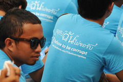 Anti-Corruption Rally in Bangkok. Students wear an anti-corruption t-shirts at a rally organised by the United Nations Development Programme outside Bangkok Art Royalty Free Stock Images