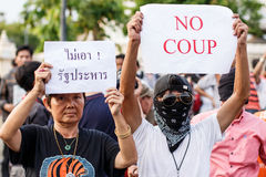 Anti Coup Protest THAILAND 25/5/2014. Protesters holding anti-coup signs in front of Victory Monument, Bangkok on 25/5/2014 Royalty Free Stock Images