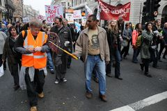 Anti-Cuts Protest in London. Protesters march through central London in opposition to government spending cuts March 26, 2011 in London, UK. An estimated 250,000 royalty free stock image