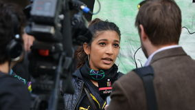 An Anti Cuts Protester Gives an Interview to News Media. A protester gives an interview to news media at an anti spending cuts rally on May 30, 2015 in London Stock Photos