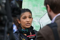 An Anti Cuts Protester Gives an Interview to News Media. A protester gives an interview to news media at an anti spending cuts rally on May 30, 2015 in London Stock Photo