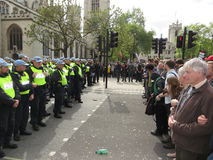 Anti Fascists square up against police during  the BNP during a Royalty Free Stock Photo