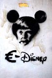 Anti-Germany graffiti representing German chancellor Angela Merkel as Mickey Mouse Stock Image