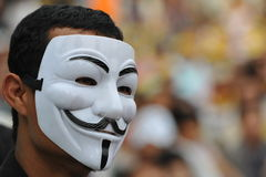 Anti-Government People's Army Group Rally in Bangkok. A masked protester attends an anti-government rally at Lumpini Park on August 4, 2013 in Bangkok, Thailand Stock Images