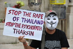 Anti-Government People's Army Group Rally in Bangkok. A masked protester attends a several thousand strong anti-government rally at Lumpini Park on August 4 Royalty Free Stock Photos