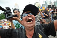 Anti-Government People's Army Group Rally in Bangkok. A protester shouts anti-government slogans while attending a several thousand strong anti-government rally Royalty Free Stock Photography