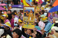 Anti-Government People's Army Group Rally in Bangkok. A royalist protester holds a portrait of the Thai king while attending an anti-government rally at Lumpini Stock Photography